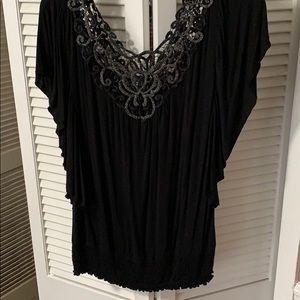 Black with silver around neckline